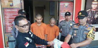 Dua tersangka pengedar uang palsu diringkus di Tanjungpinang. (suryakepri.com/mba)