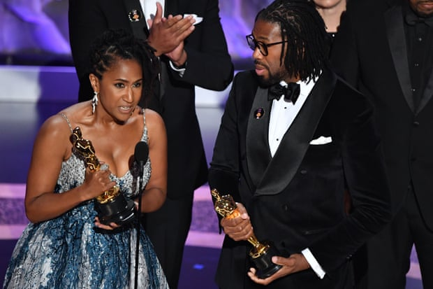 Karen Rupert Toliver and director Matthew A Cherry accept the award for best animated short for Hair Love. Photograph: Mark Ralston/AFP/Getty Images