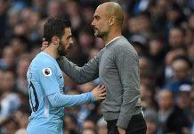 Kapten Manchester City Bernardo Silva (kiri) dan manajer City Pep Guardiola. Keduanya berbeda pendapat soal kinerja tim saat kalah 0-2 dari Manchester United di Old Trafford.