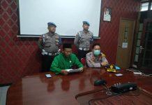 Kepala Dinas Kesehatan Kota Tanjungpinang Rustam, didampingi Kabag Sumda Kompol H.Jaswir saat mengumumkan dua anggota Polres Tanjungpinang negatif Covid-19 di kantor Dinkes Tanjungpinang (Suryakepri.com)