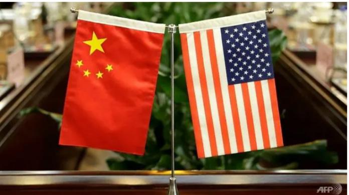 Ketegangan antara AS dan China meningkat dimana kedua negara terlibat pertarungan supremasi global.(Foto: AFP / Jason Lee via CNA)