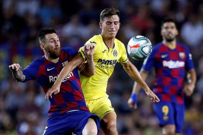 Pau Torres berduel dengan penyerang Barcelona Lionel Messi. (Foto dari BeeSoccer)