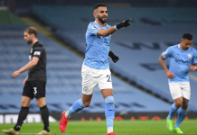 Gelandang Manchester City Riyad Mahrez melakukan selebrasi usai mencetak gol ketiganya atau hat-trick ke gawang Burnley pada lanjutan Liga Inggris di Stadion Etihad, Sabtu (28/11/2020). (Foto: Premierleague.com)