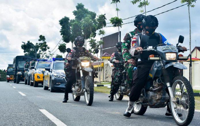 TNI-Polri saat menggelar patroli skala besar di wilayah Kabupaten Bintan (Suryakepri.com)