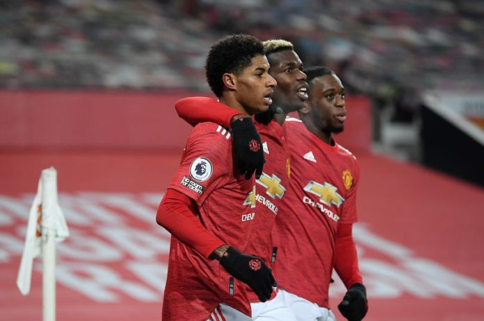 Tiga pemain Manchester United; Marcus Rashford, Paul Pogba, dan Aaron Wan-Bissaka. Manajer Ole Gunnar Solskjaer mengutamakan kebugaran pemain dengan strategi rotasi untuk hadapi jadwal padat. (Foto dari MEN Sports)
