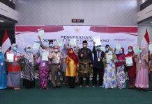 Penyerahan sertifikat tanah secara simbolis kepada warga Tanjungpinang (Suryakepri.com)