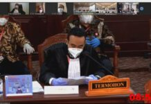 KPU Karimun melalui kuasa hukumnya memberikan jawaban di sidang MK, Jumat (5/2/2021). Foto Suryakepri.com/Tangkap layar video streaming sidang gugatan Pilkada Karimun di MK.