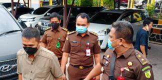 Tersangka Yudi Ramdani saat digiring ke Rutan Polres Tanjungpinang (Suryakepri.com/Muhammad Bunga Ashab)