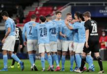 Para pemain Manchester City merayakan gol pembuka dari Kevin De Bruyne di menit ke-12 dalam kemenangan 2-0 atas Borussia Moenchengladbach pada babak 16 besar Liga Champions 2020/21. (Foto dari Uefa.com)