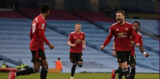 Bek kiri Manchester United Luke Shaw melakukan selebrasi usai mencetak gol kedua dalam kemenangan 2-0 atas tuan rumah Manchester City di Etihad pada Minggu (7/3/2021) atau Senin dinihari waktu Indonesia. (Foto dari Premierleague.com)