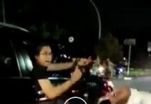 Aksi koboi pengemudi mobil Toyota Fortuner mengacungkan