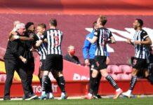 Gelandang Newcastle Joe Willock meraih hasil imbang 1-1 melawan Liverpool di Anfield dengan satu gol di masa injury time.