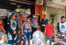 Komunitas motor trail Trial Adventure Comunity (TAC) Kota Batam berbagi sembako kepada warga di daerah tembesi