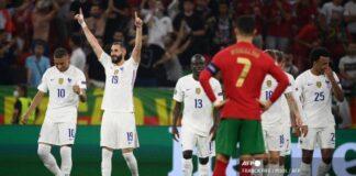 Pemain depan Prancis Karim Benzema merayakan mencetak gol kedua tim selama pertandingan sepak bola Grup F UEFA EURO 2020 antara Portugal dan Prancis di Puskas Arena di Budapest pada 23 Juni 2021. FRANCK FIFE / POOL / AFP (FRANCK FIFE / POOL / AFP)