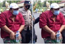 MH (46) warga Dusun Munder, Yosowilangun saat digelendeng ke Polres Lumajang, Jumat (11/6/2021).