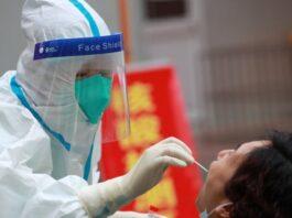Pengujian SARS-2-CoV di Wuhan, Cina, tempat kasus pertama COVID-19 dilaporkan. Kredit: Zhao Jun Getty Images via .scientificamerican.com)