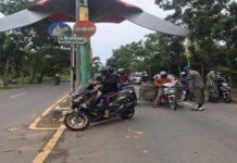 Foto suasana penyekatan PPKM Darurat di Perbatasan Tanjungpinang-Bintan Tugu Keris Km 16 Desa Toapaya Selatan, Rabu (14/7/2021)