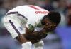 Reaksi pemain Inggris Marcus Rashford setelah gagal mencetak gol penalti melawan Italia pada final EURO 2020 di stadion Wembley di London, Minggu, 11 Juli 2021. Italia mengalahkan Inggris 3-2 dalam adu penalti adu penalti setelah pertandingan berakhir imbang 1-1. (Carl Recine/Pool Photo via AP)