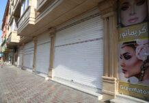 'Kaum perempuan yang memiliki bisnis telah menutup toko, restoran ... Semua salon kecantikan telah menutup pintu mereka.' (Foto: Xinhua/REX/Shutterstock via Guardian)