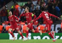 Kapten Liverpool Jordan Henderson merayakan gol dari tendangan voleinya ke gawang AC Milan yang memastikan kemenangan 3-2 atas AC Milan pada laga Grup G Liga Champions 2021/22 di Anfield, Rabu (15/9/2021). (Uefa.com)