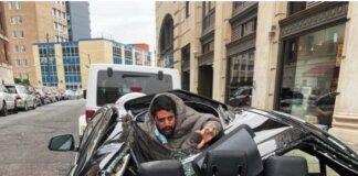 Seorang pria jatuh setinggi 30 meter dari gedung sembilan lantai, tubuhnya menimpa mobil BMW hitam, tetapi dia selamat dan hanya mengalami patah lengan. (Kredit: Christina Bri via The Sun)