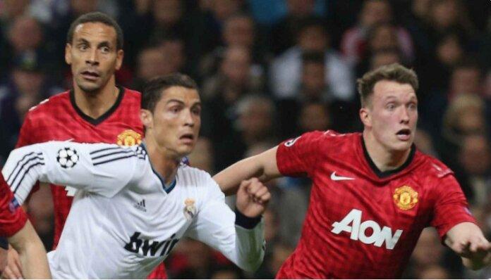 Phil Jones (kanan) dimainkan sebagai gelandang bertahan oleh Sir Alex Ferguson dengan tugas utama mengawal ketat Cristiano Ronaldo pada laga Liuga Champions 2012/2013 melawan Real Madrid di Santiago Bernabeu. Laga berakhir imbang 1-1, dan Ronaldo mencetak gol balasan setelah mereka tertinggal 0-1. (Foto: manutd.com)